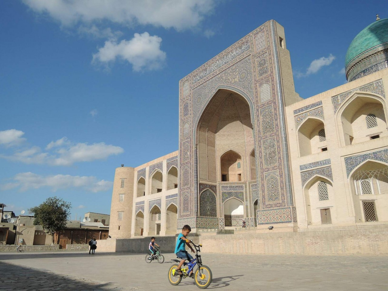 Kids on bycicle in Bukhara