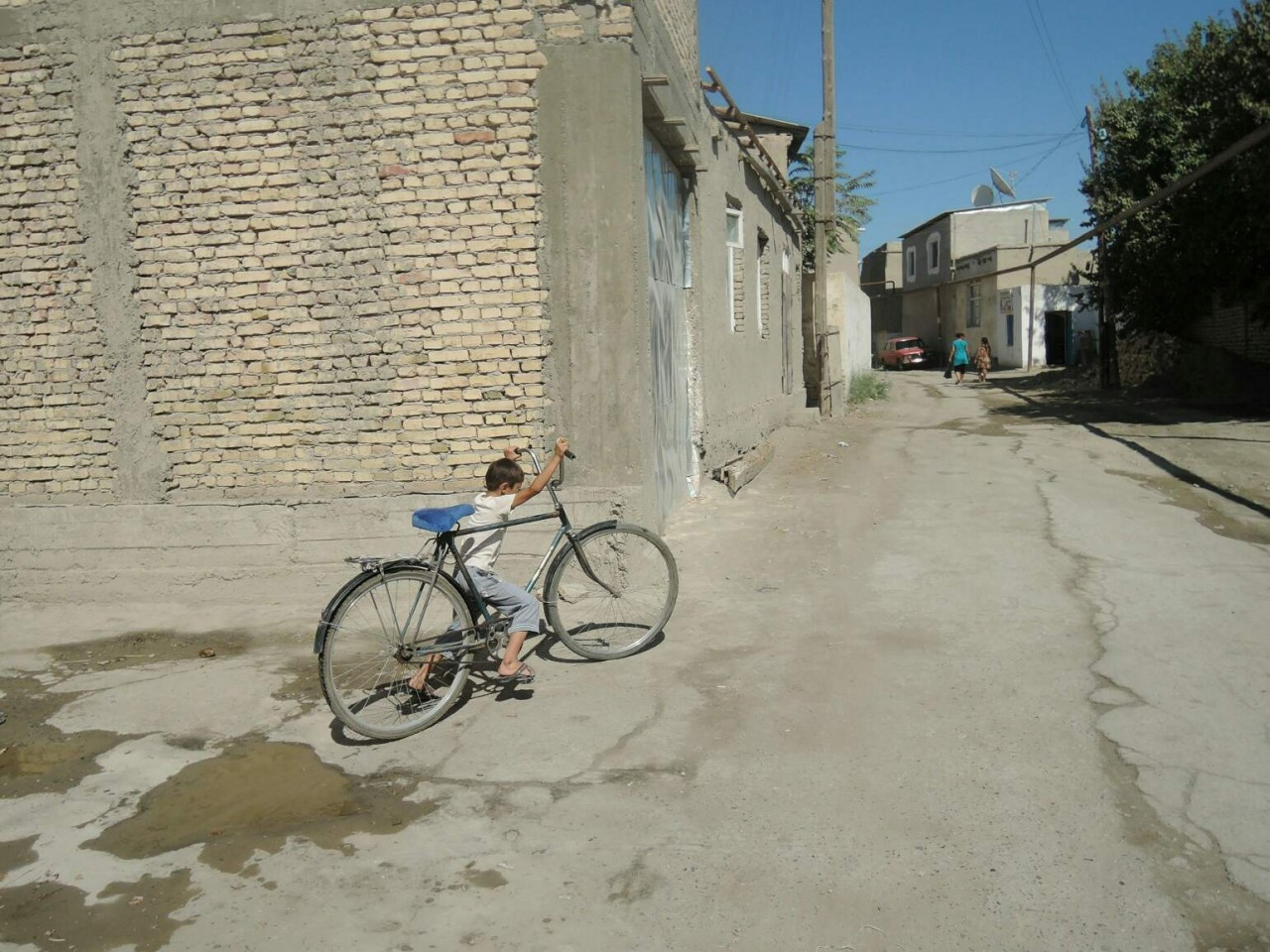 Kid with bycicle in Uzbekistan