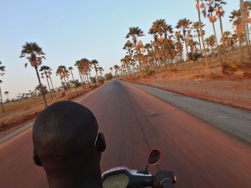 hitchhiking a scooter in senegal